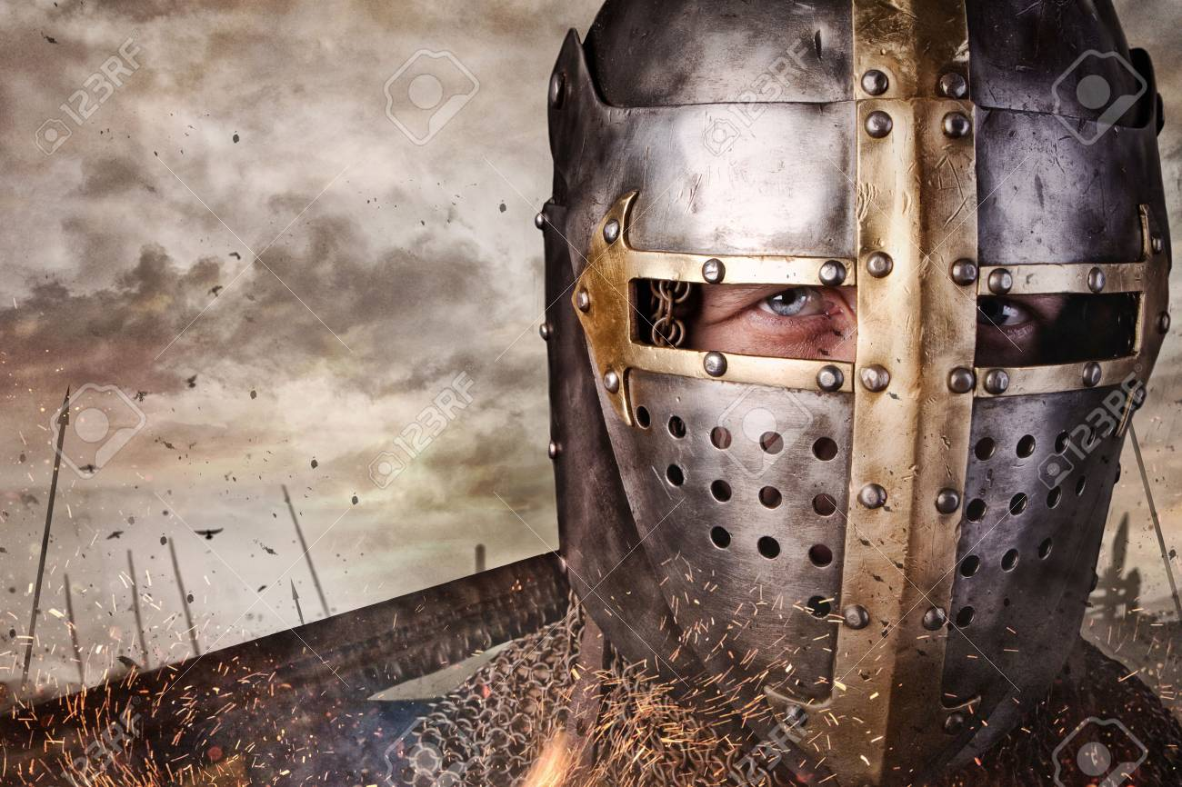 Close up portrait of a man in knight helmet. - 62831354
