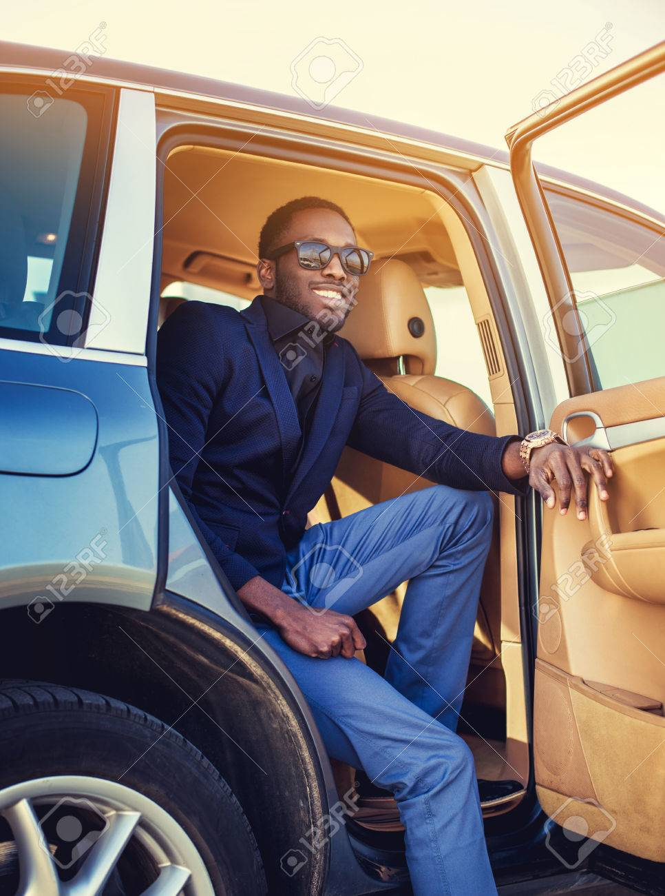 Stylish African American Male Posing In A Car S Back Seat Stock Photo Picture And Royalty Free Image Image 62832231