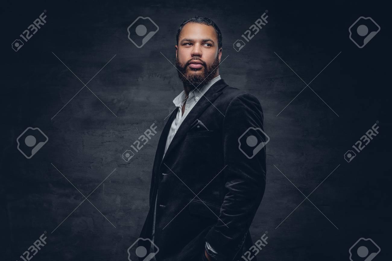 Portrait of bearded black man in a wool suit. - 71355840