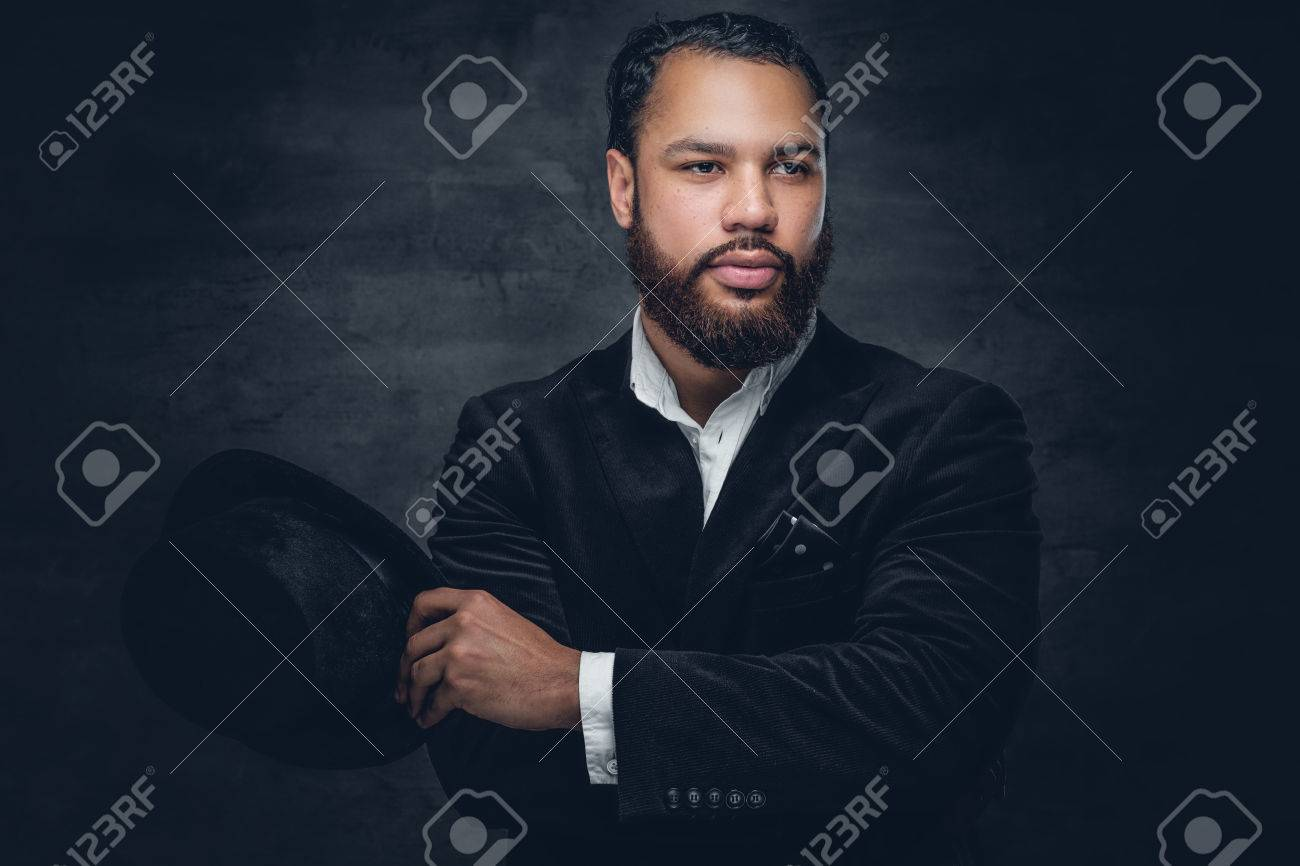 Bearded black man wearing a suit and a felt hat. - 71666390