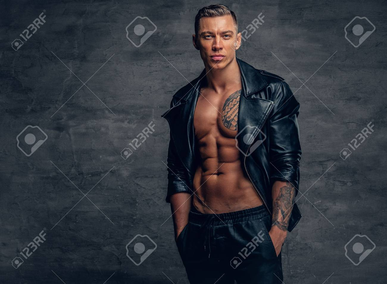 Stylish Muscular Male With Tattoo On A Chest, Dressed In A Black ...