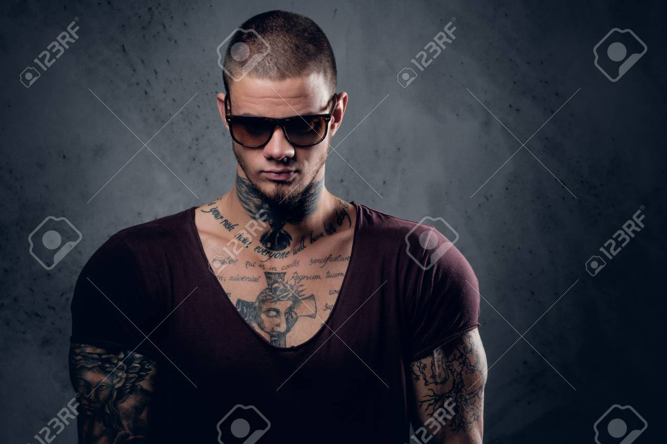 Handsome Athletic Male In Sunglasses With Tattoos On His Arms