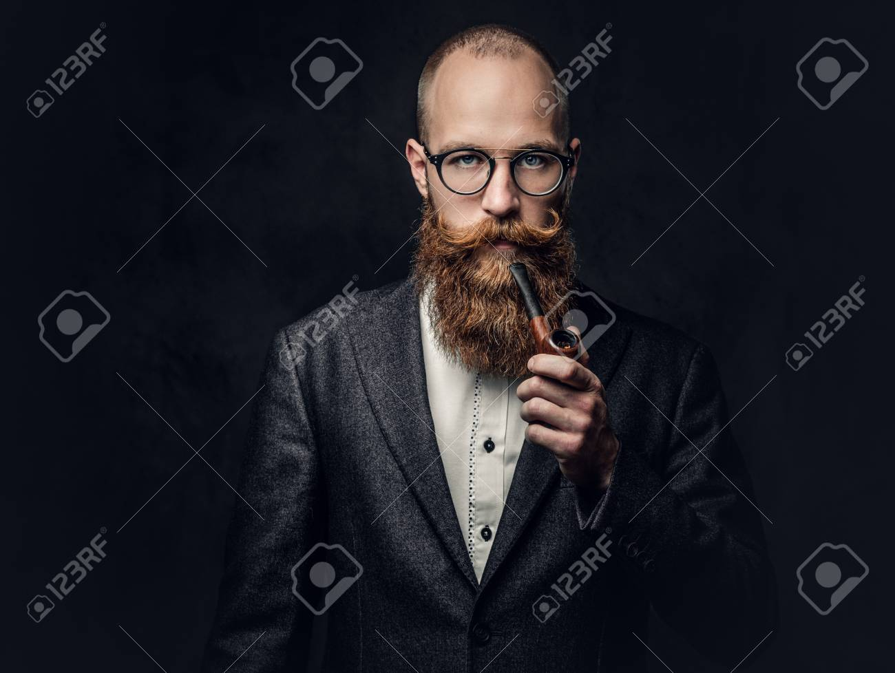 A man smoking pipe over grey background. - 90063467