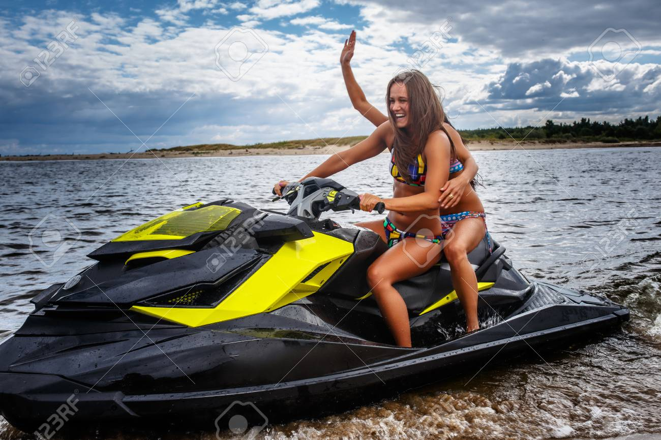 Two Sexy Girls In A Swimwear Sitting On A Jet Ski Have Fun Stock Photo Picture And Royalty Free Image Image 98698180