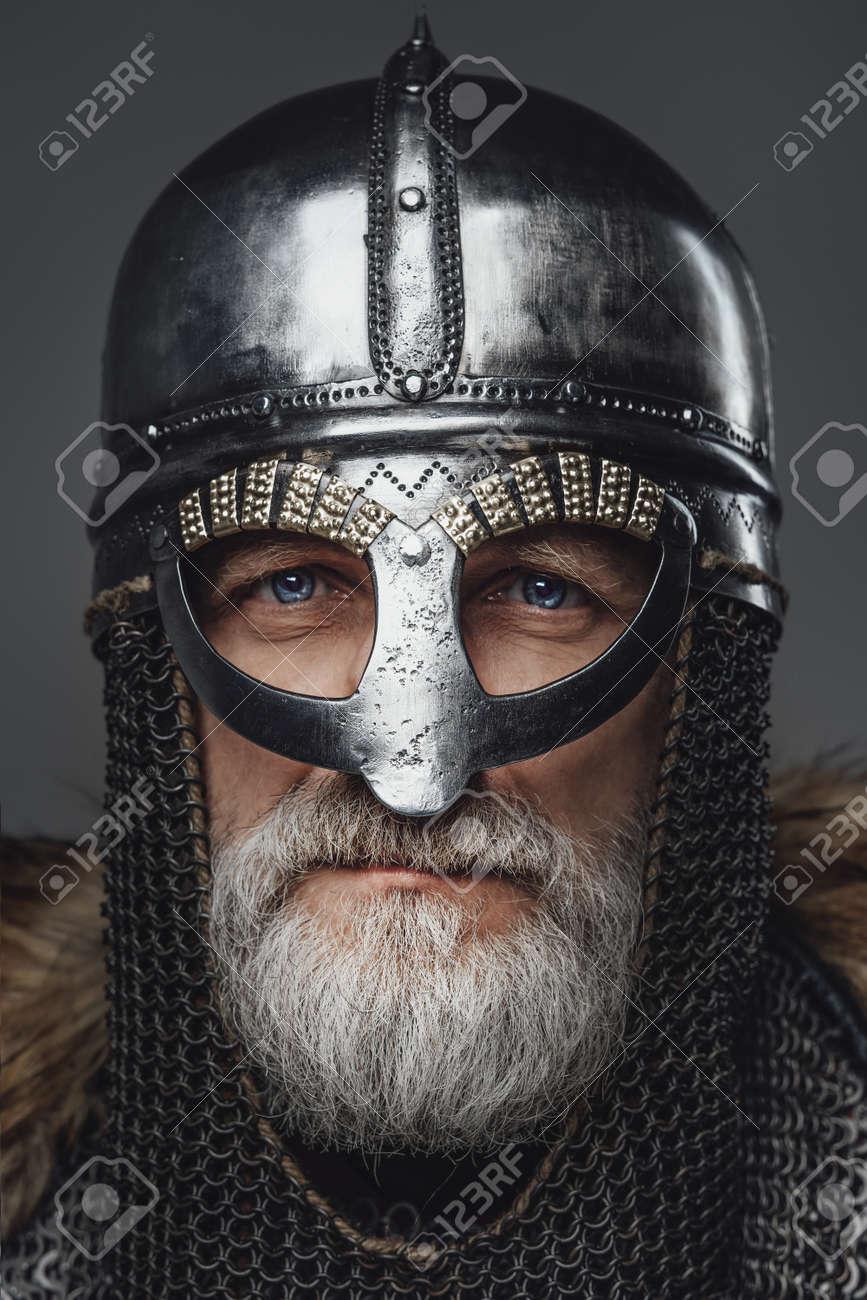 Closeup portrait of elder viking warrior with helmet - 169222484