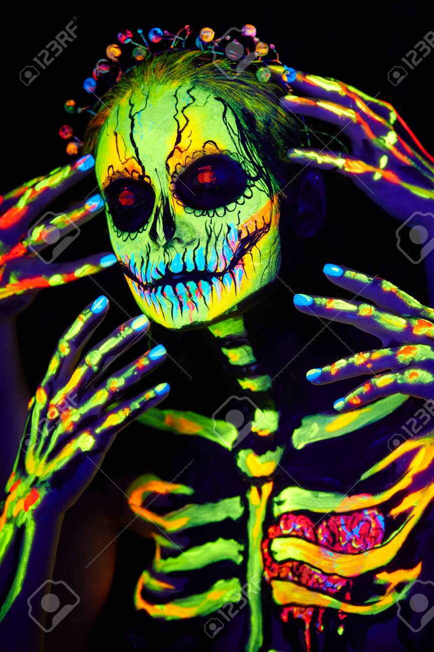 Uv Body Art Painting Of Helloween Female Skeleton Stock Photo Picture And Royalty Free Image Image 132535949