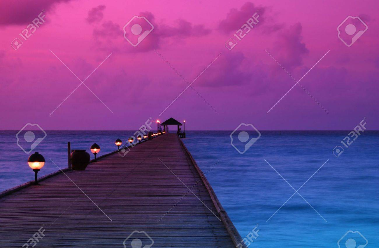 Beautiful sunrise over the sea and jetty in the Maldives, Indian Ocean Stock Photo - 6411296