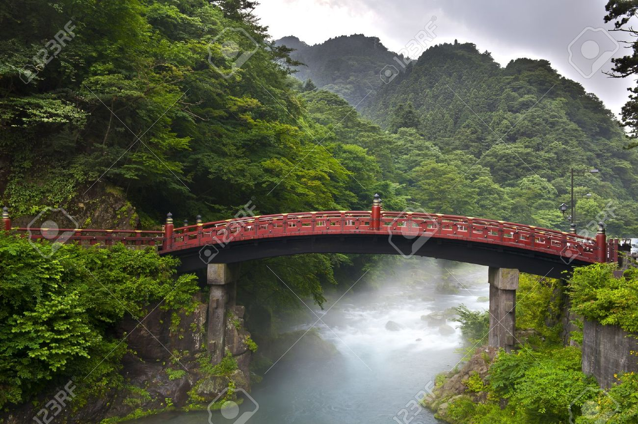 Red sacred bridge Shinkyo in Nikko, Japan and a mist rising from the river - 8848267