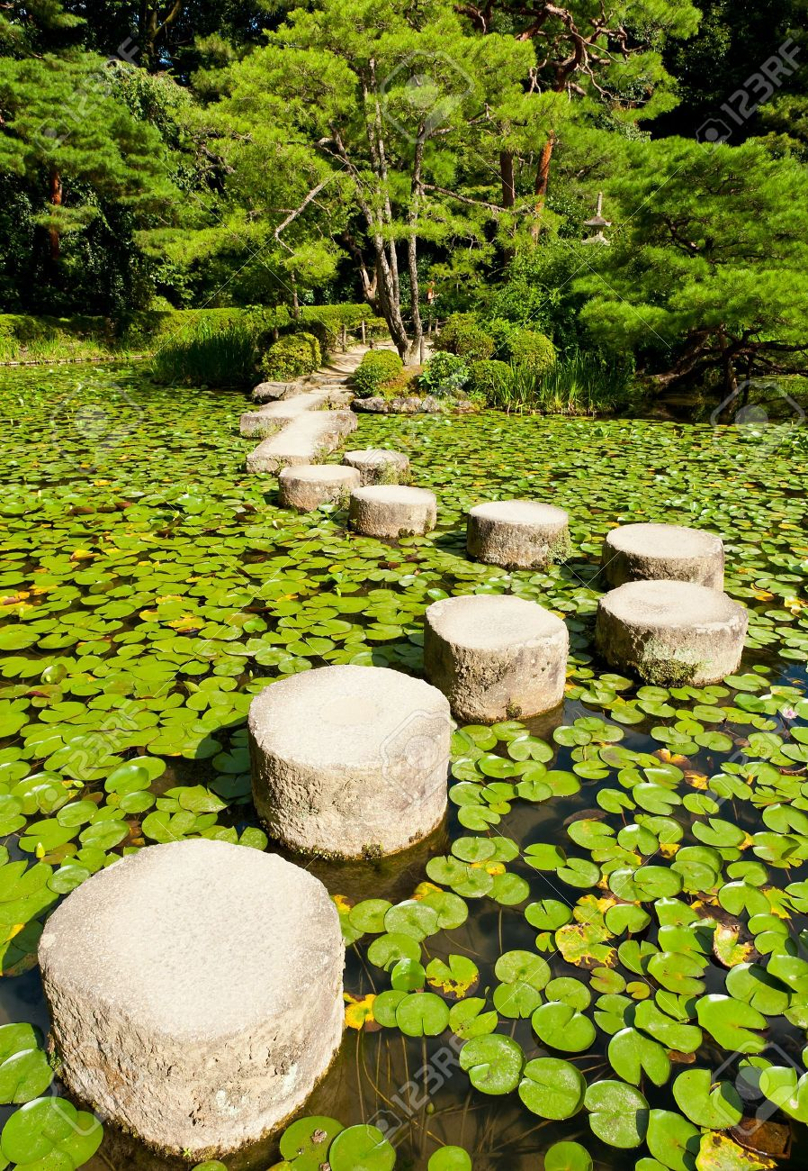 Zen stone path in a Japanese Garden near Heian Shrine.Stones are surrounded by lotus leaves Stock Photo - 11257705