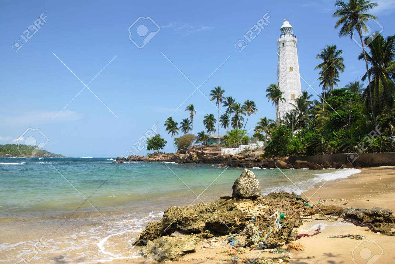 Beautiful white lighthouse Dondra Head, the southest cape of Sri Lanka - seen from the beach. The lighthouse is also a highest (161 feet) not only on the island but also in the whole Asia Stock Photo - 11425502
