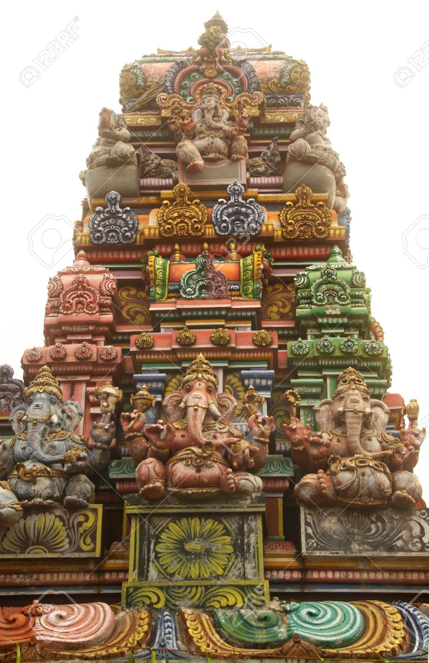 Tower of beautiful hindu temple with a Ganesha (elephant deity) statues isolated on white Stock Photo - 11425467