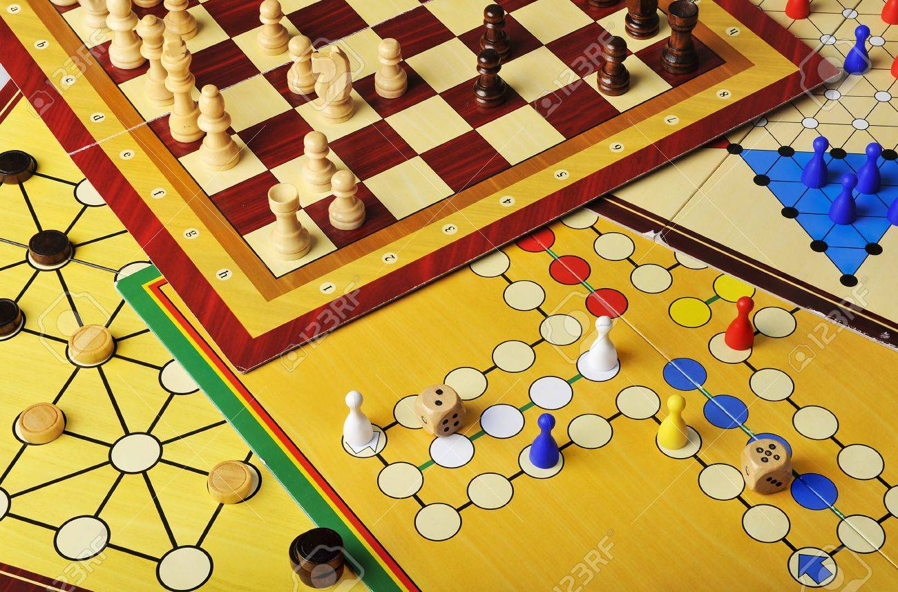 Various board games of ludo, halma, chess and fox and geese Stock Photo - 12868849