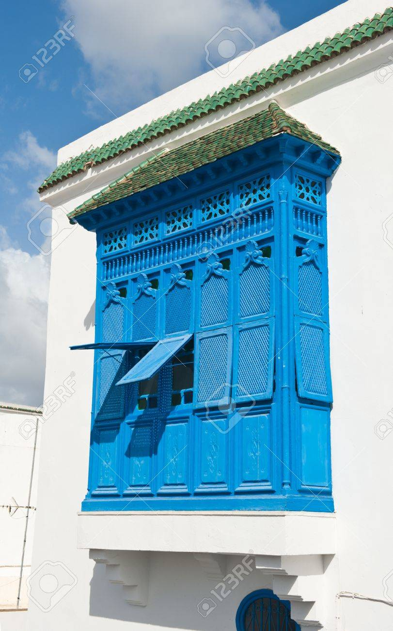 Beautiful ornamental blue windows on a white wall so typical for Tunisia Stock Photo - 17161896