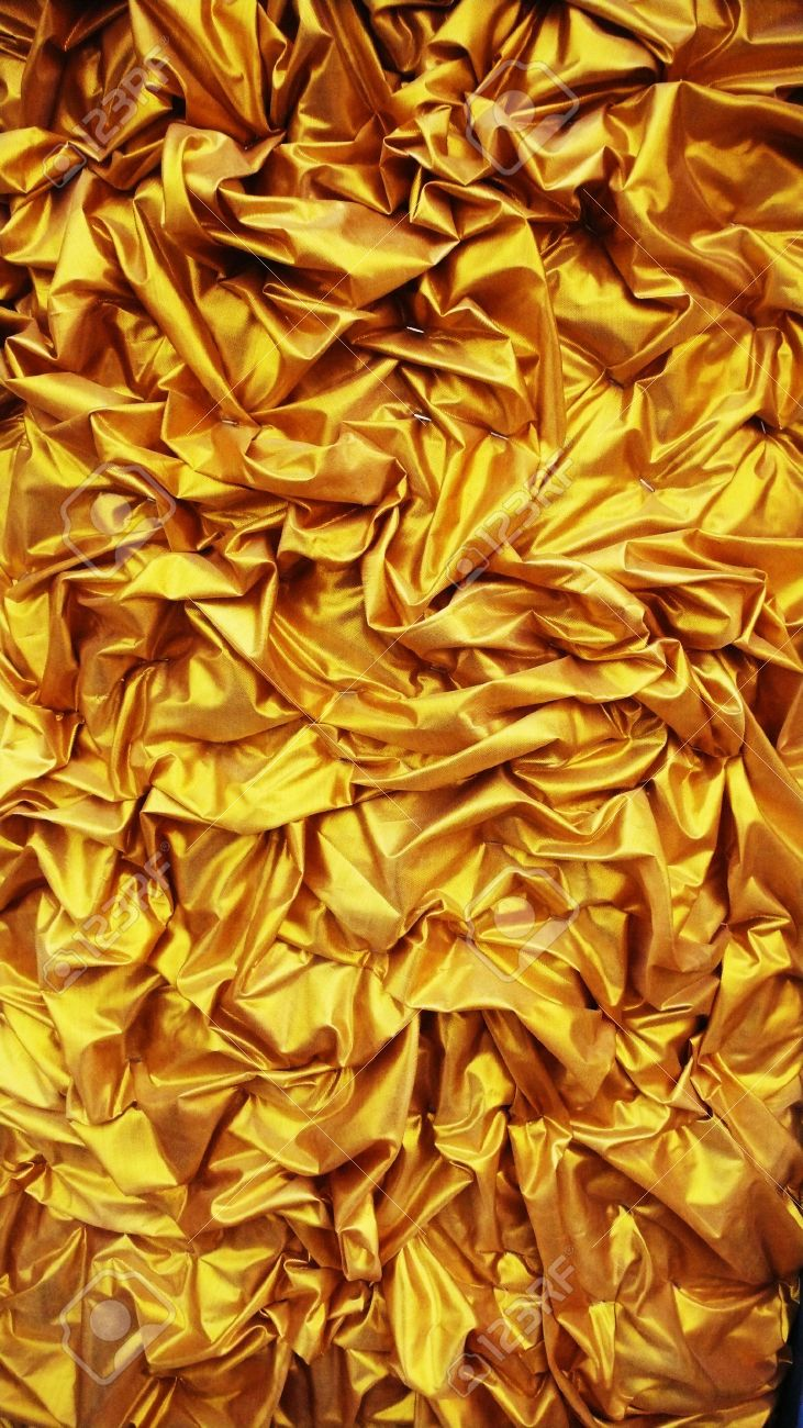 Fabric Folds Into A Light Golden Color Texture Wallpaper Effects