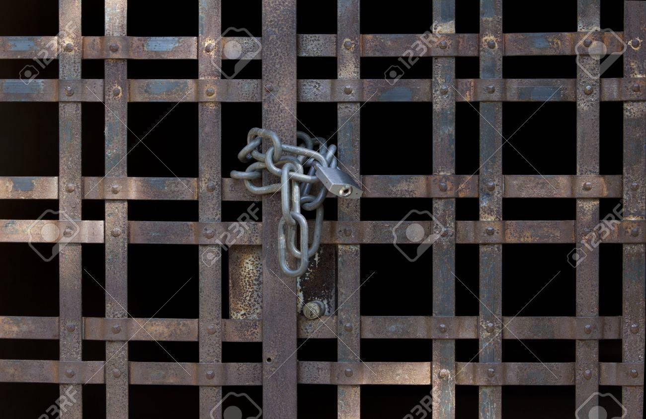 Old grid door locked by a chain Stock Photo - 7965112