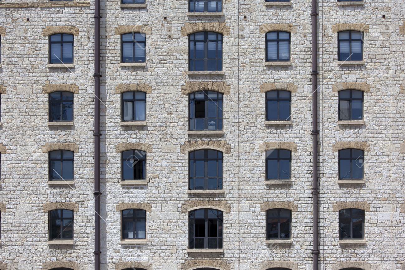 Window facade  Facade Of An Old Style Stone Building Showing A Symmetric Array ...