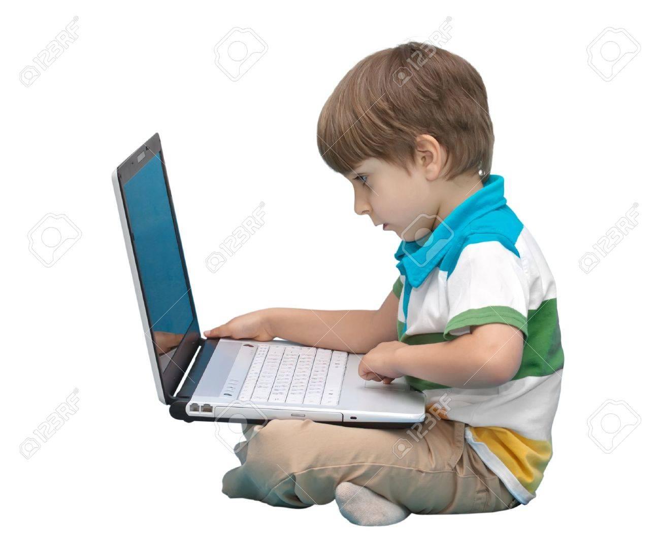Boy with laptop isolated on white background Stock Photo - 9334207