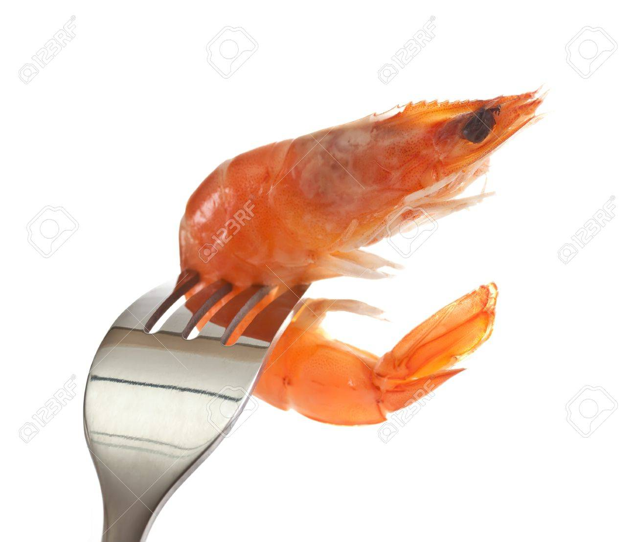 Boiled shrimp on a fork. - 11219213