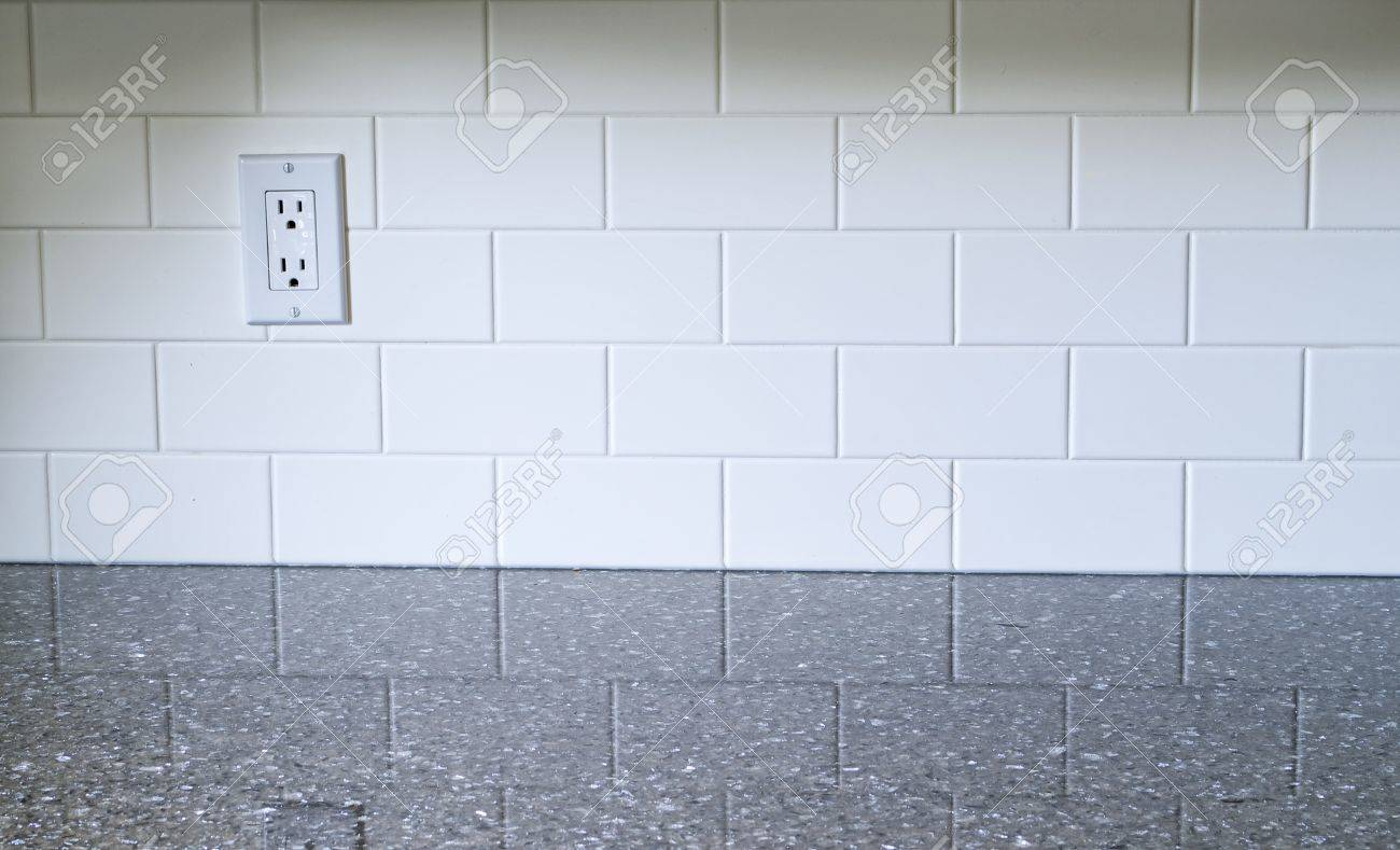White Kitchen Backsplash With A White Outlet On The Left Side ...
