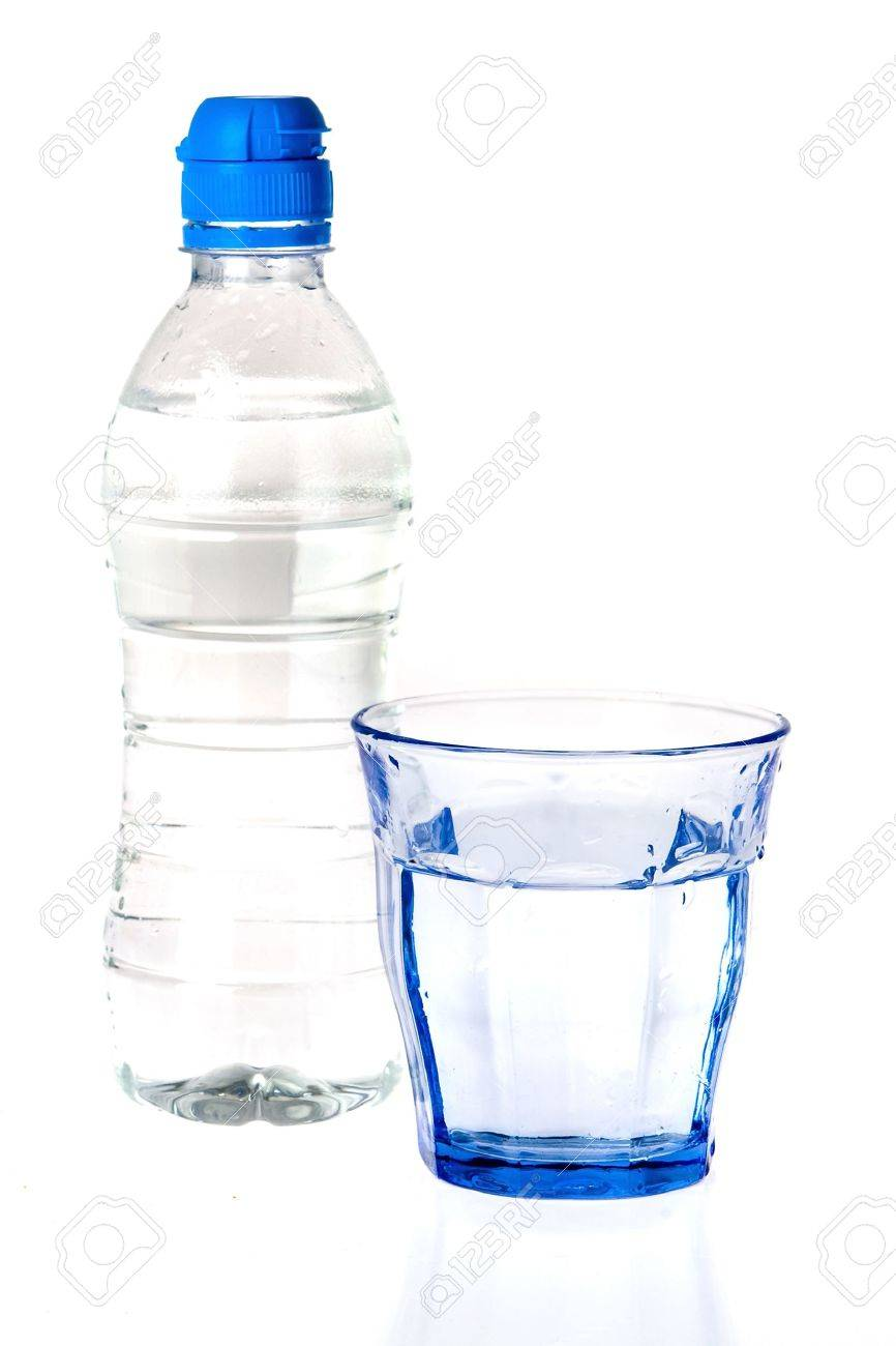 a blue glass and a bottle of water on a white background Stock Photo - 8598500