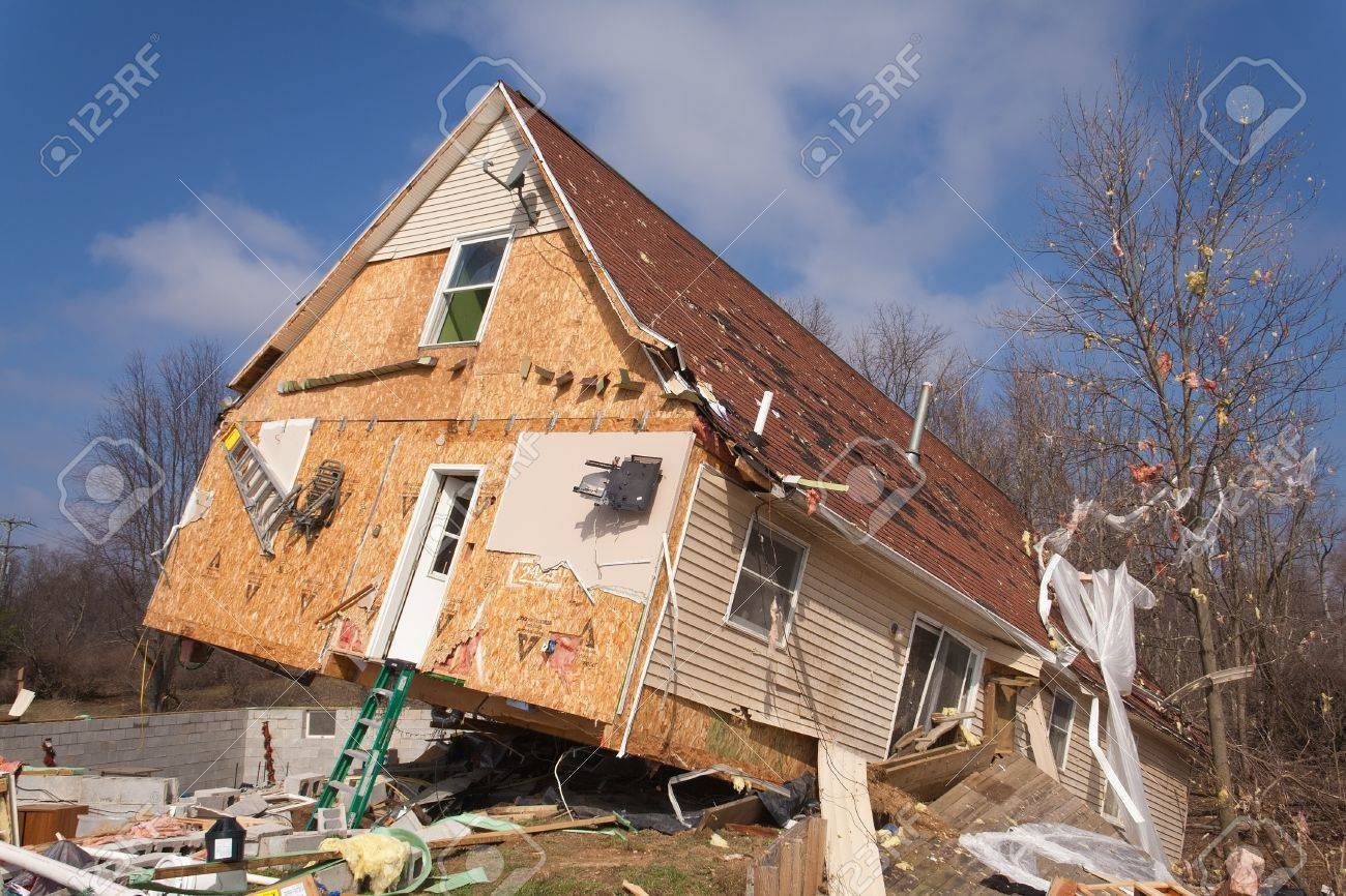 LAPEER COUNTY, MI - MARCH 16  A home heavily damaged by an F2 tornado that swept through Oregon Twp in Lapeer County, MI on March 15, 2012  The house was lifted from its foundation  Stock Photo - 12926370