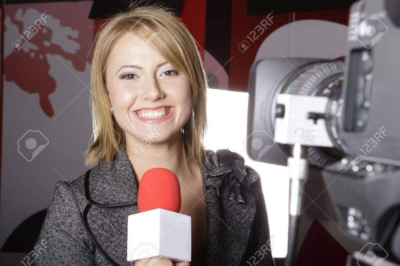 live TV transmission with a smiling reporter in front of the video camera - 4035063