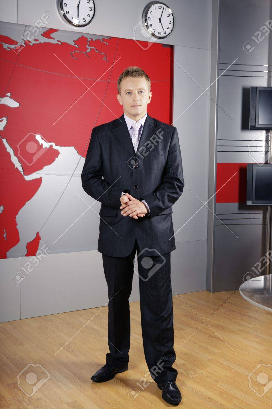 full length news presenter standing in front of the camera in a television studio Stock Photo - 4568705