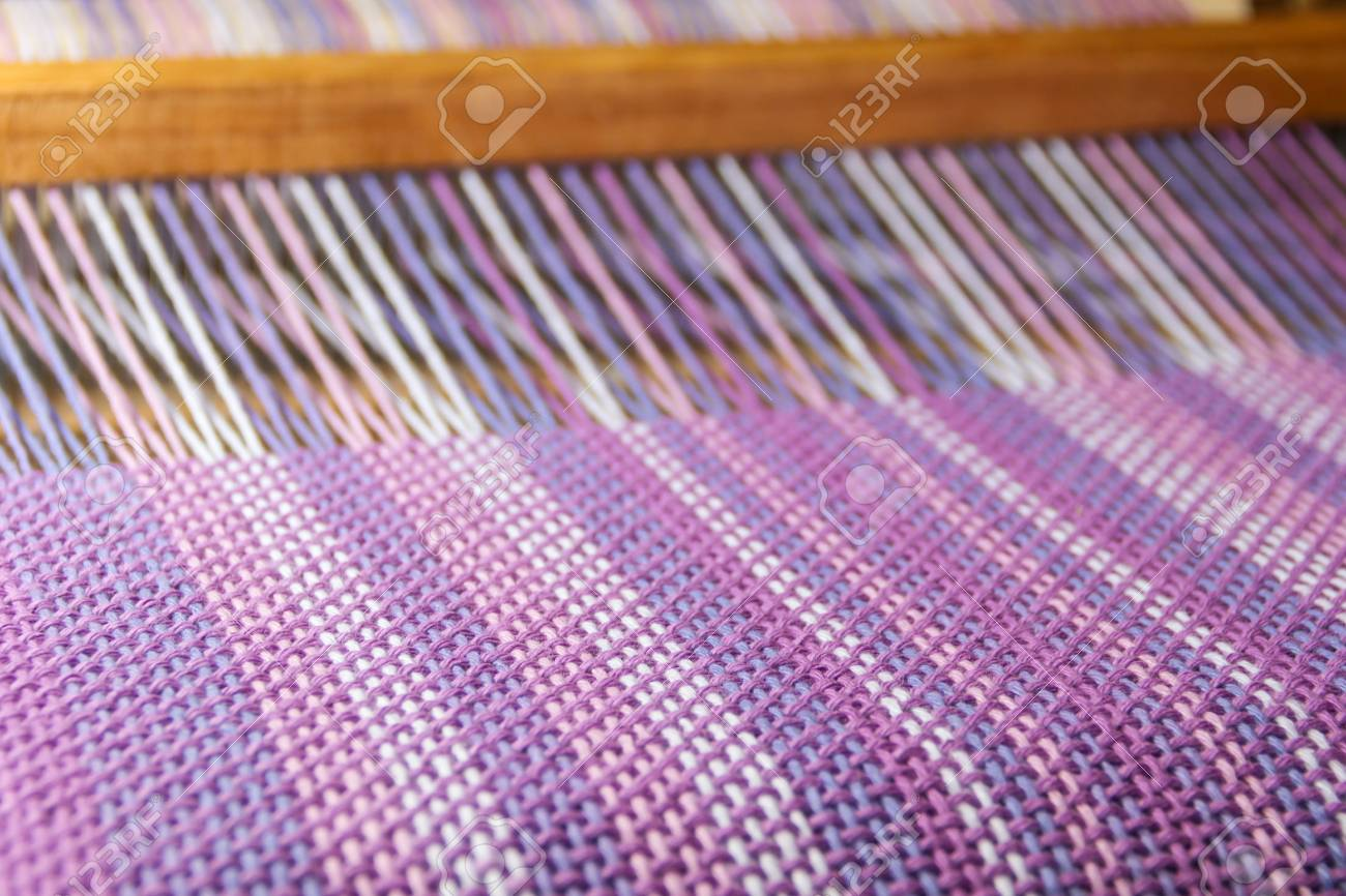 detail of fabric in comb loom with ultraviolet and lilac colors - 103993271