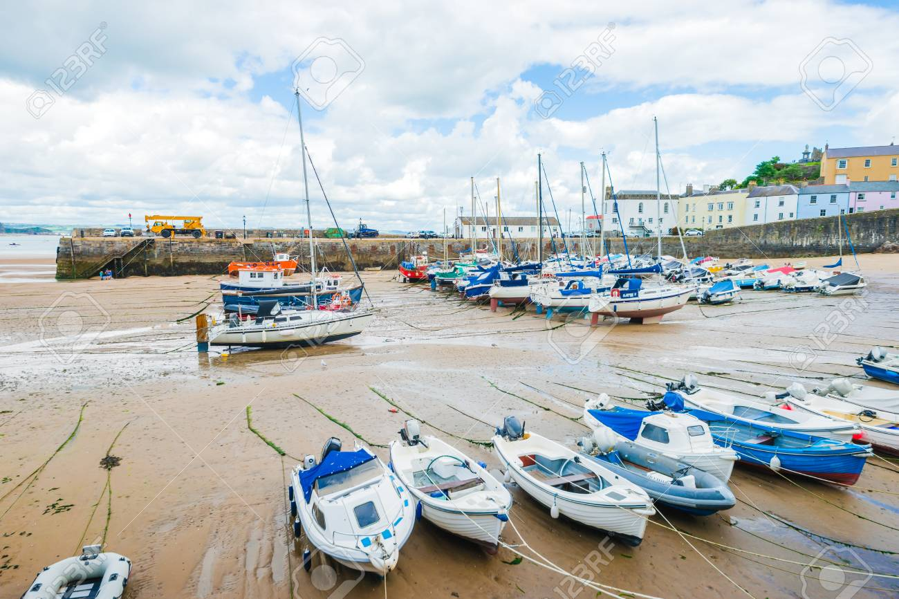 Boats On The Sandy Beach At Low Tide In Tenby Bay, Wales Stock Photo,  Picture And Royalty Free Image. Image 93149865.