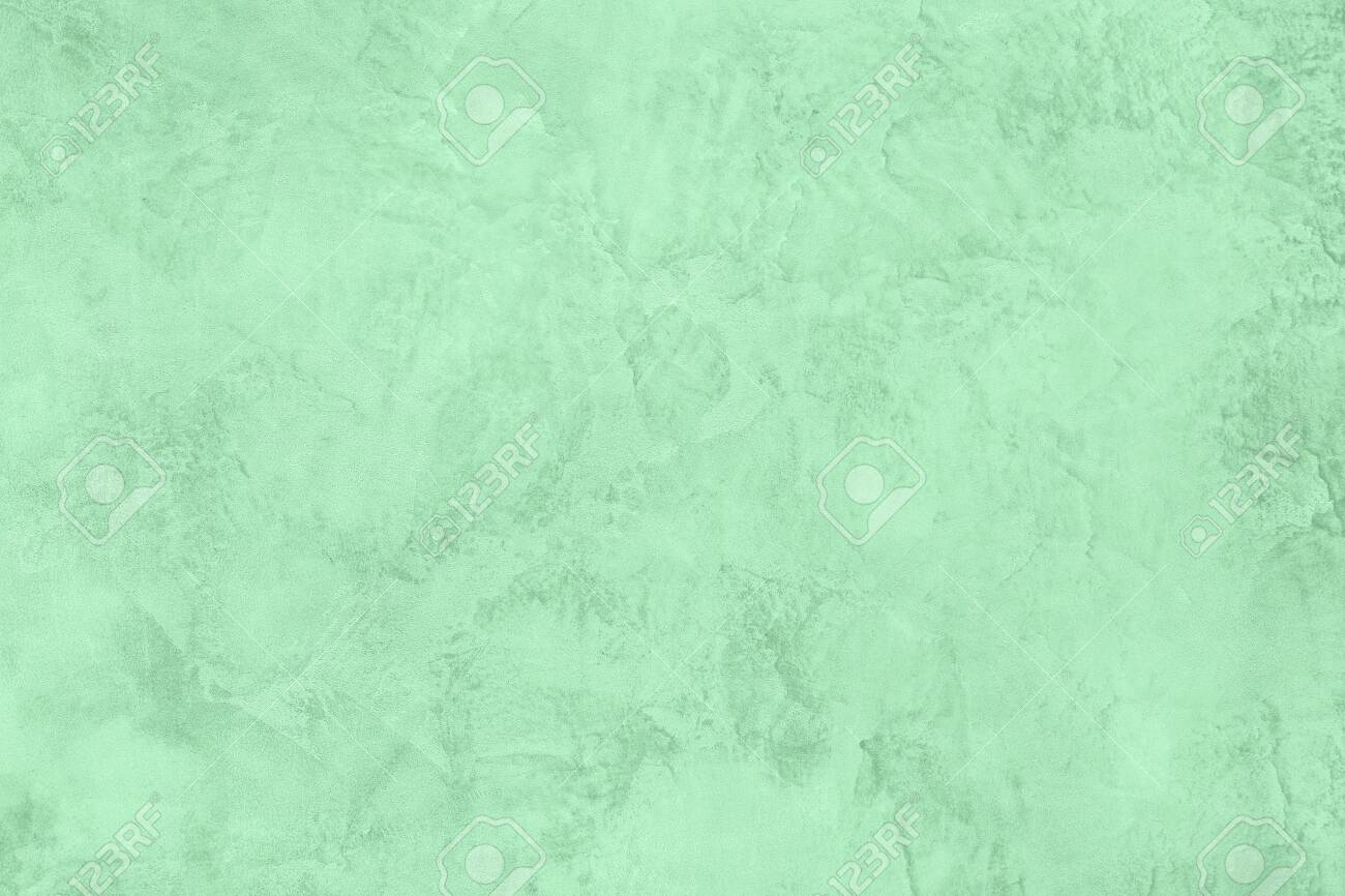 Trendy Neo mint colored low contrast Rough Concrete textured background to your concept or product. Color of the year 2020 - 123508780