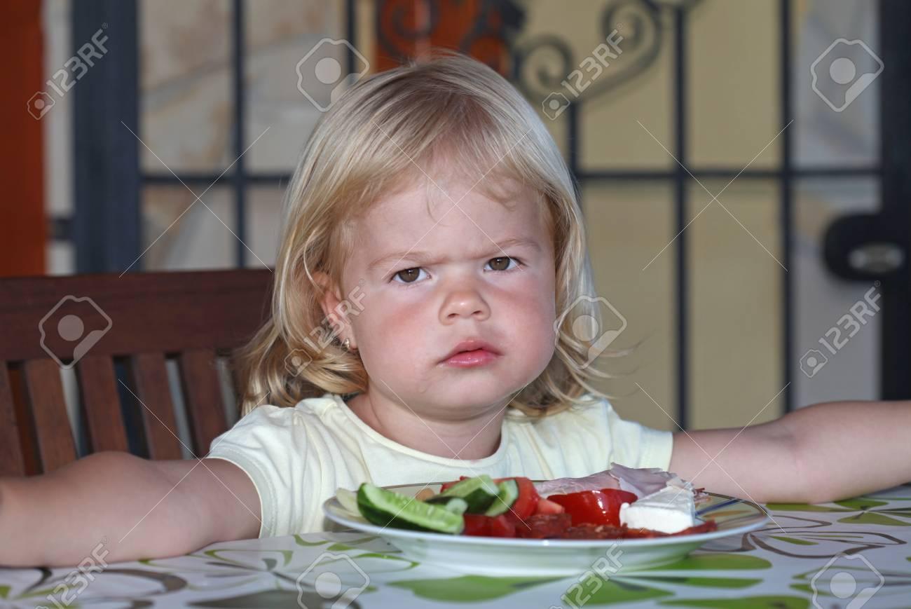 Portrait of sweet little girl having lunch - 34764680
