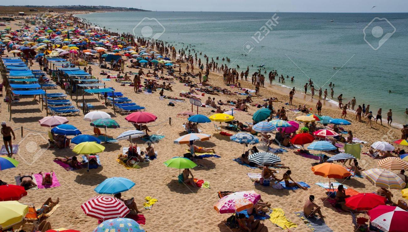 Crowded beach in summer on Algarve Coastline, Portugal - 21673907