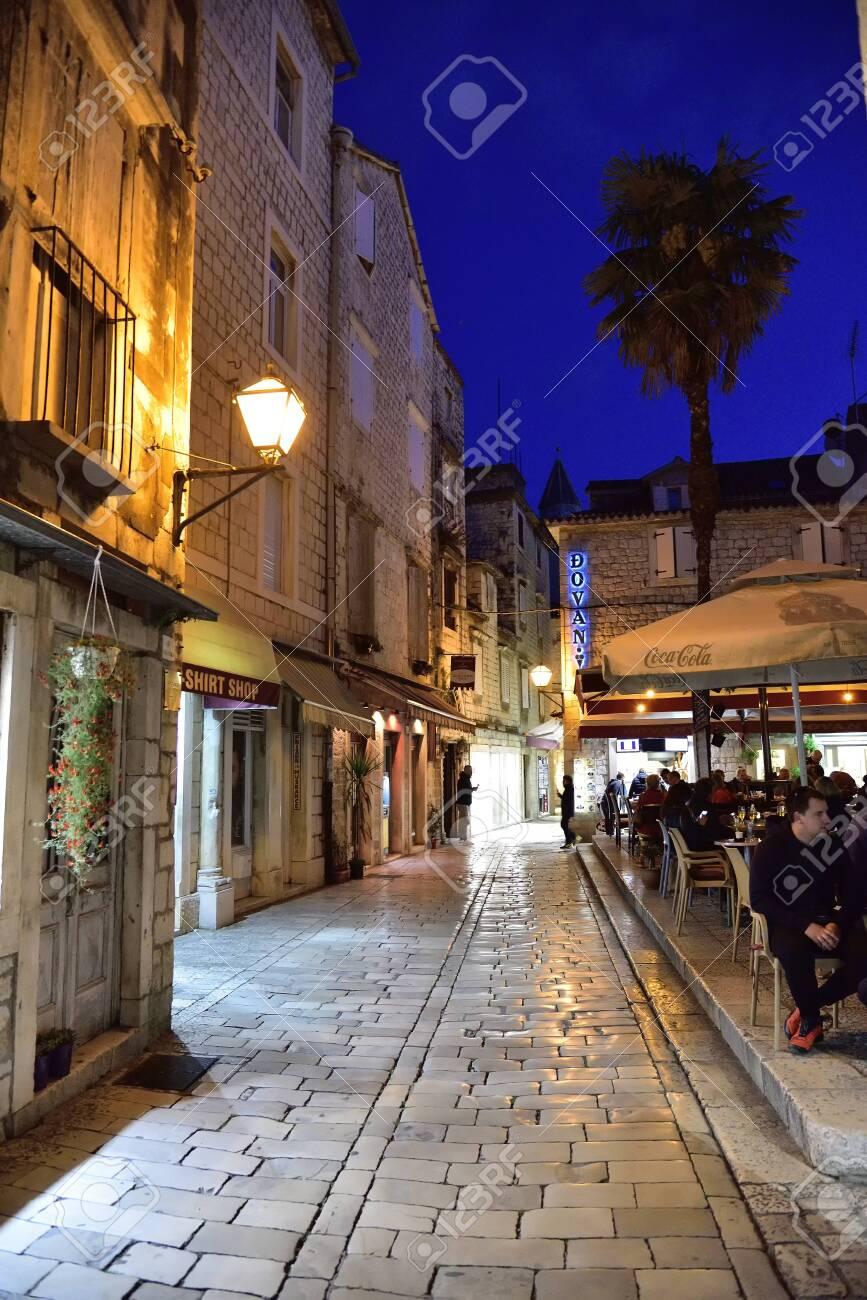 TROGIR, CROATIA - APRIL 31, 2019: Restaurant in narrow streets of mediterranean city. Trogir at night. Croatia.` - 150570789