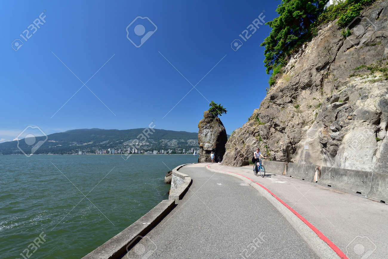 VANCOUVER, BRITISH COLUMBIA, CANADA, MAY 31, 2019: Siwash Rock, a famous rock outcropping in Vancouver - 161070540