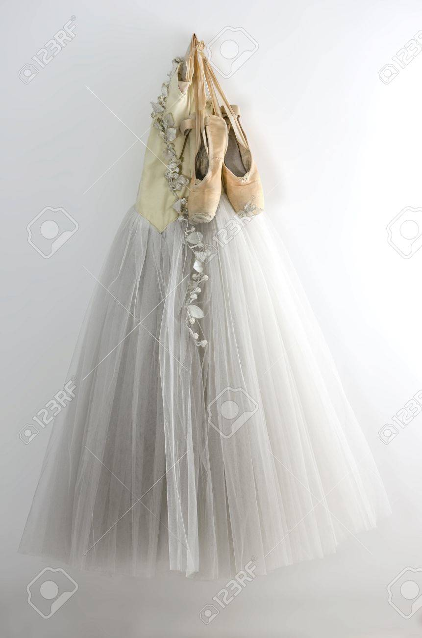 d27d59e224d9 Ballet dress and pointe shoes hanging on the wall Stock Photo - 16418463