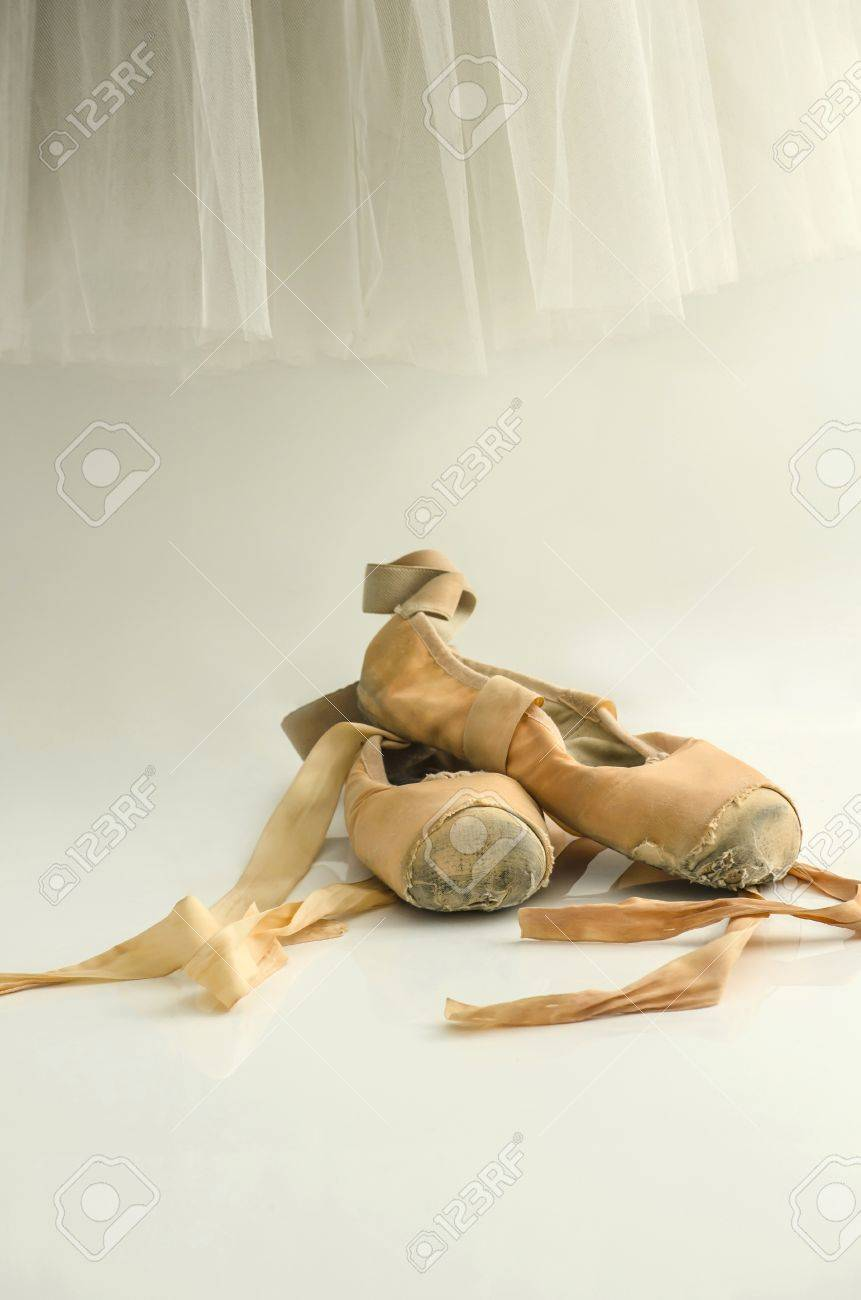 65723afee599 Ballet dress hanging on the wall and pointe shoes under it Stock Photo -  16418458