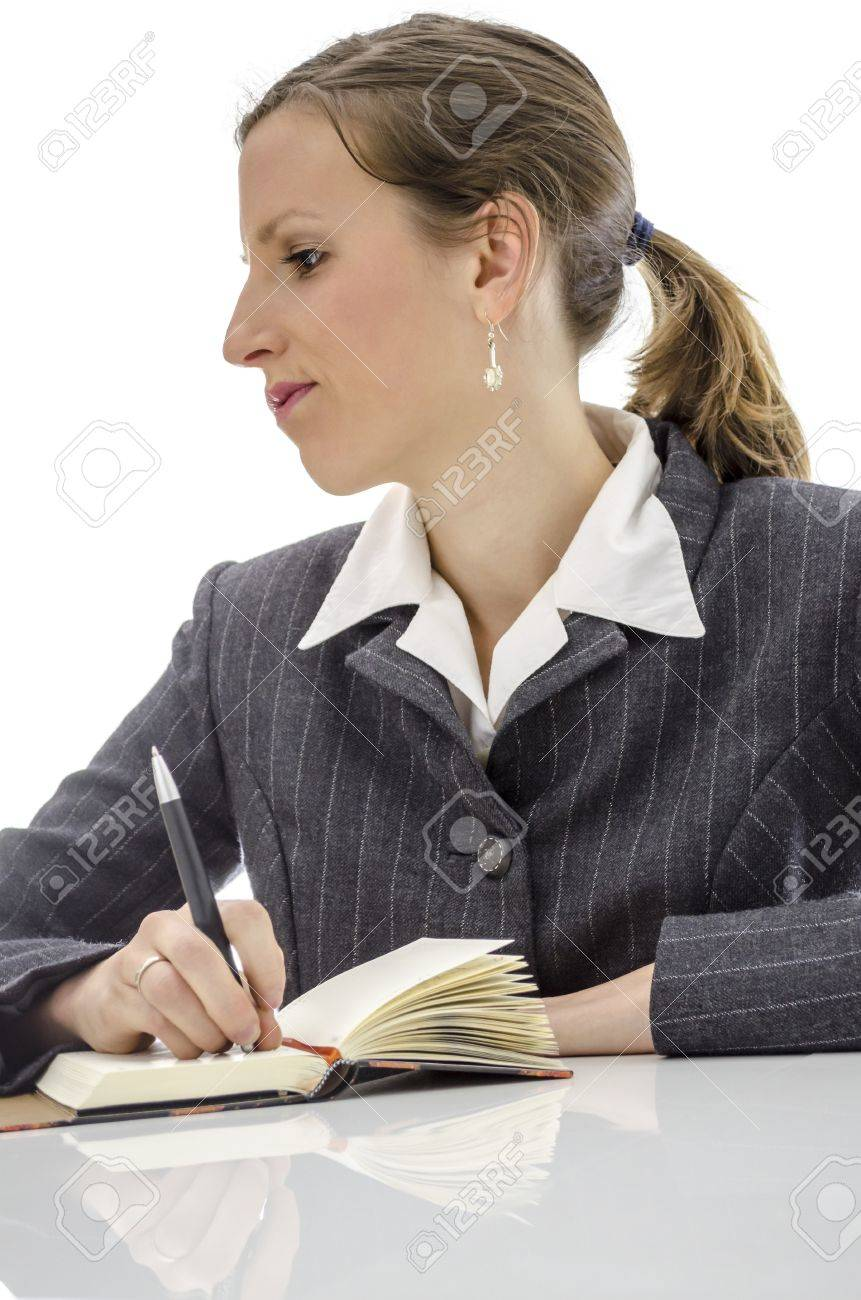 Pensive business woman thinking what to write in her diary  Isolated over white background Stock Photo - 17546135