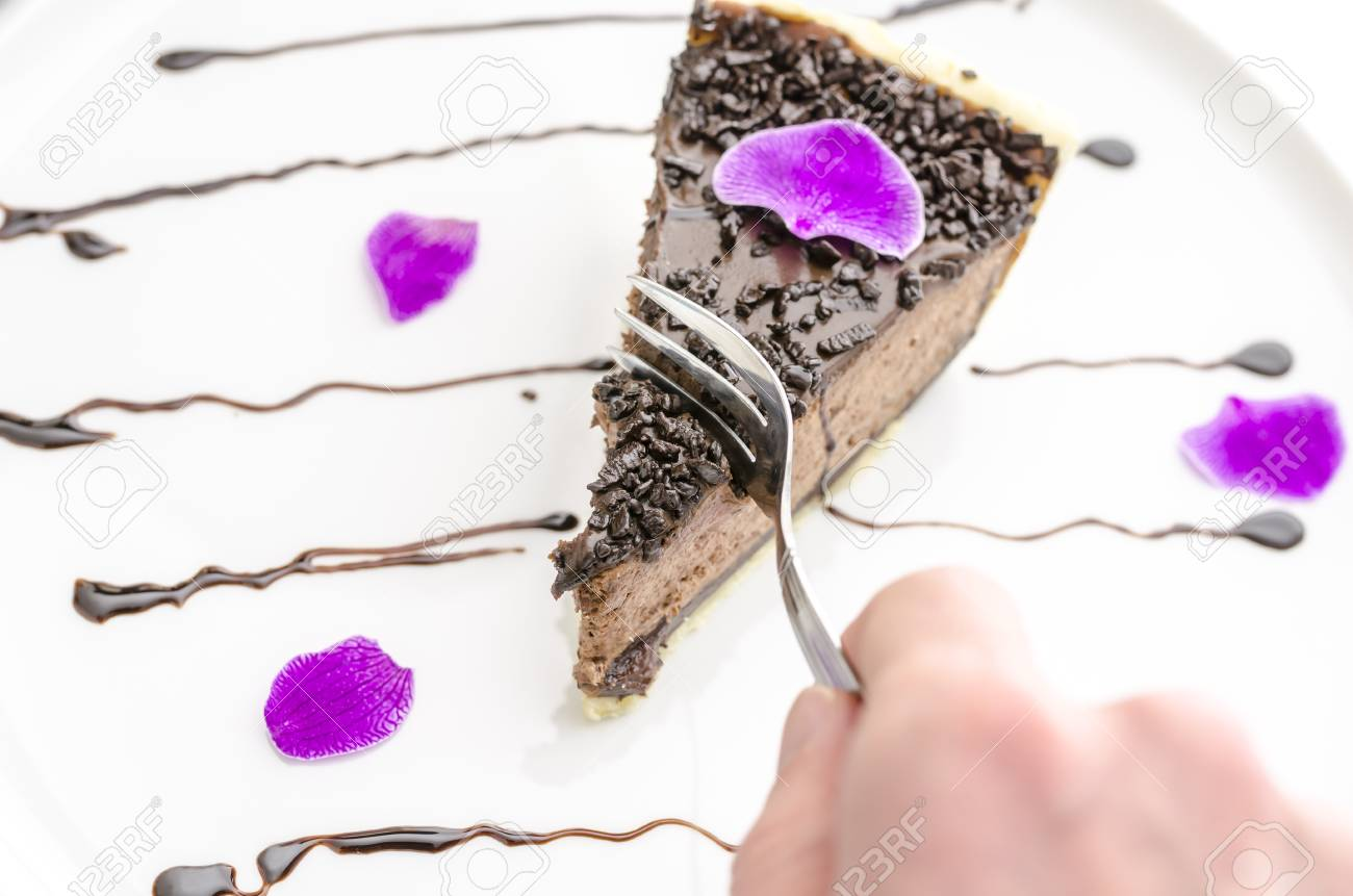 Eating a chocolate cake decorated with pink flower petal Stock Photo - 18058374