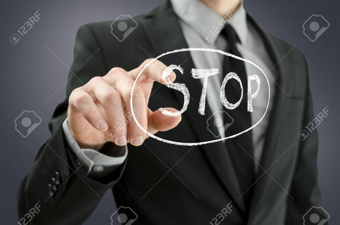 Business man pressing  stop button on a virtual screen Stock Photo - 18595300