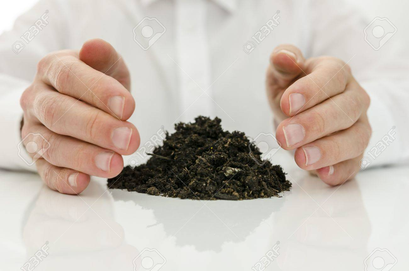 Male hands around pile of soil. Concept of alternative medicine. Stock Photo - 19614694