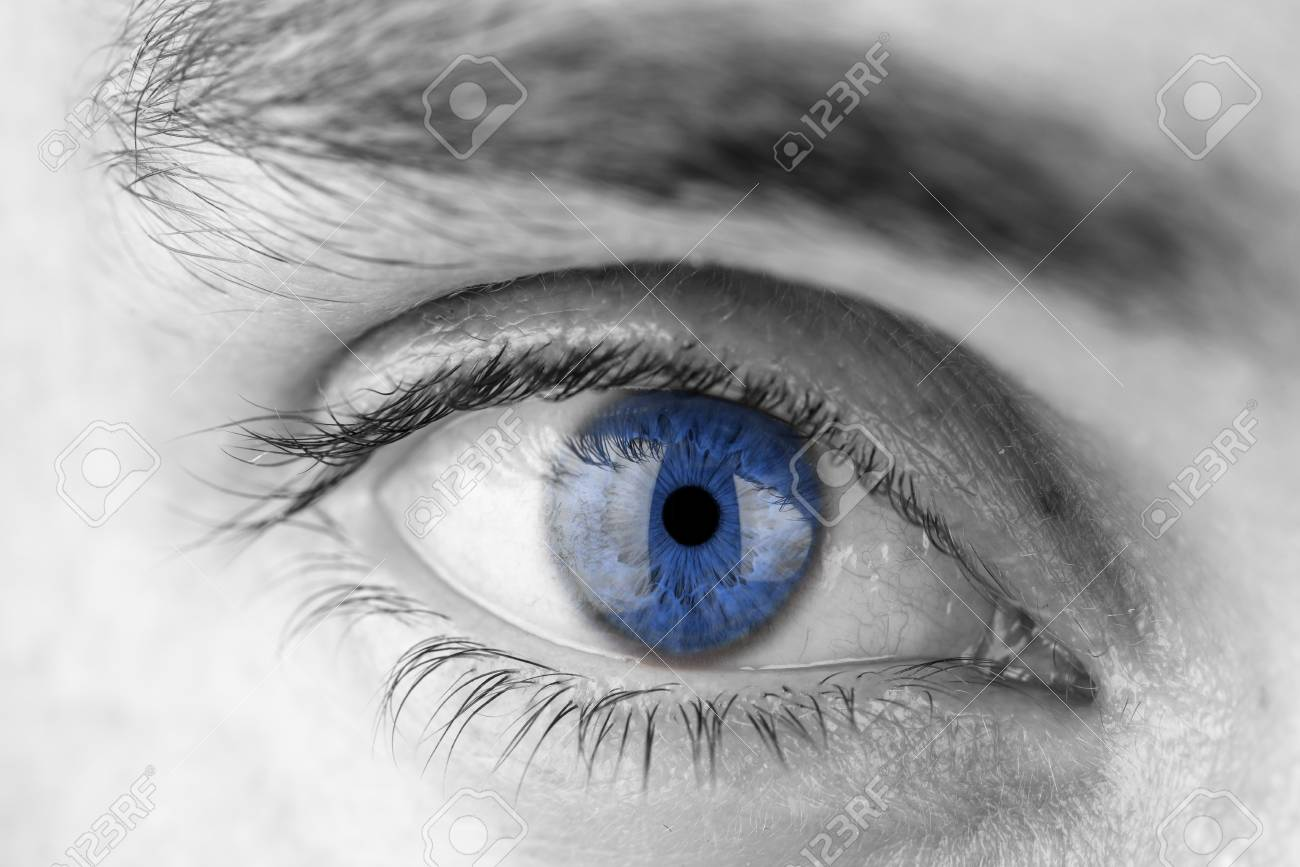Closeup of human eye with blue pupil. Stock Photo - 22861266