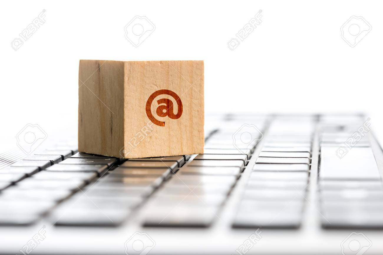 Close Up Of Wooden Block With At Symbol On Computer Keyboard Stock