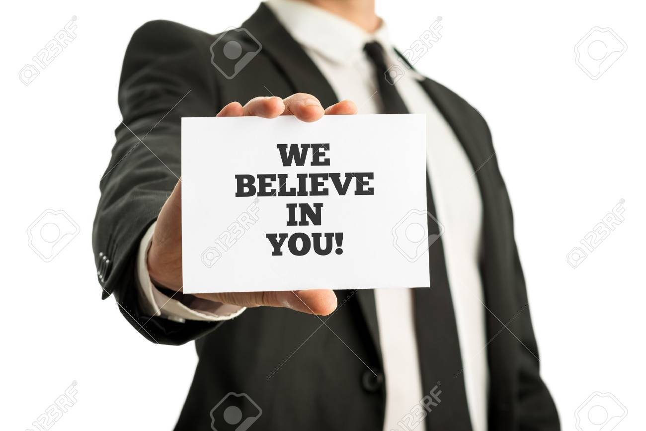Businessman In A Suit Holding Up A Business Card With Motivational ...