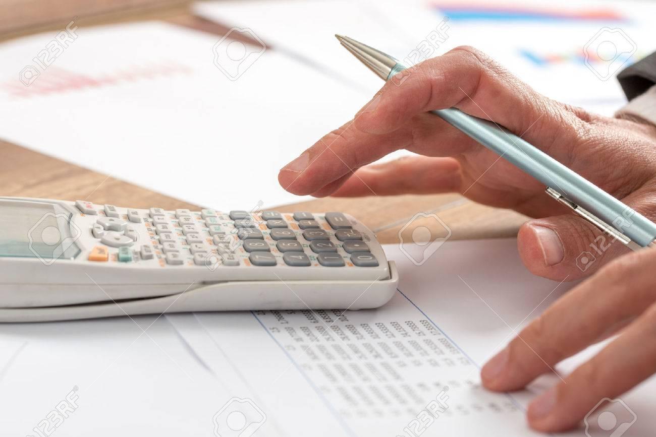 business accountant doing a calculation on a manual desk top stock rh 123rf com Accountant Room Accountant Room