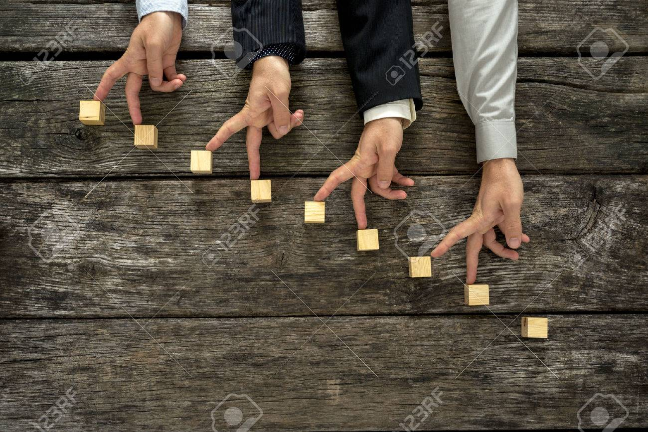 cooperation stock photos images royalty cooperation images cooperation conceptual image of teamwork and cooperation four male hands walking their fingers up