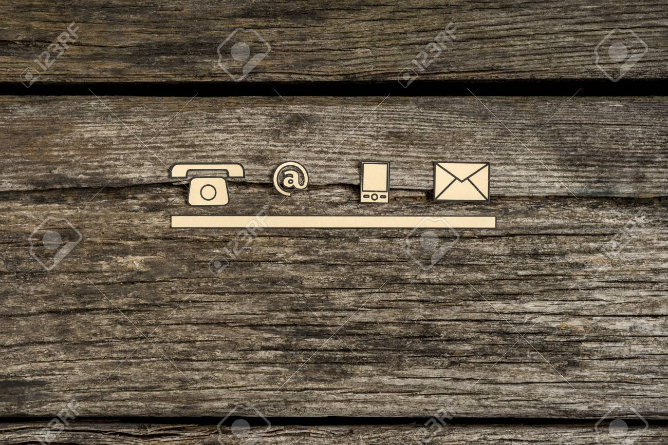 Contact and communication icons, telephone, at sign, mobile and mail, on textured rustic wooden boards. - 86581916