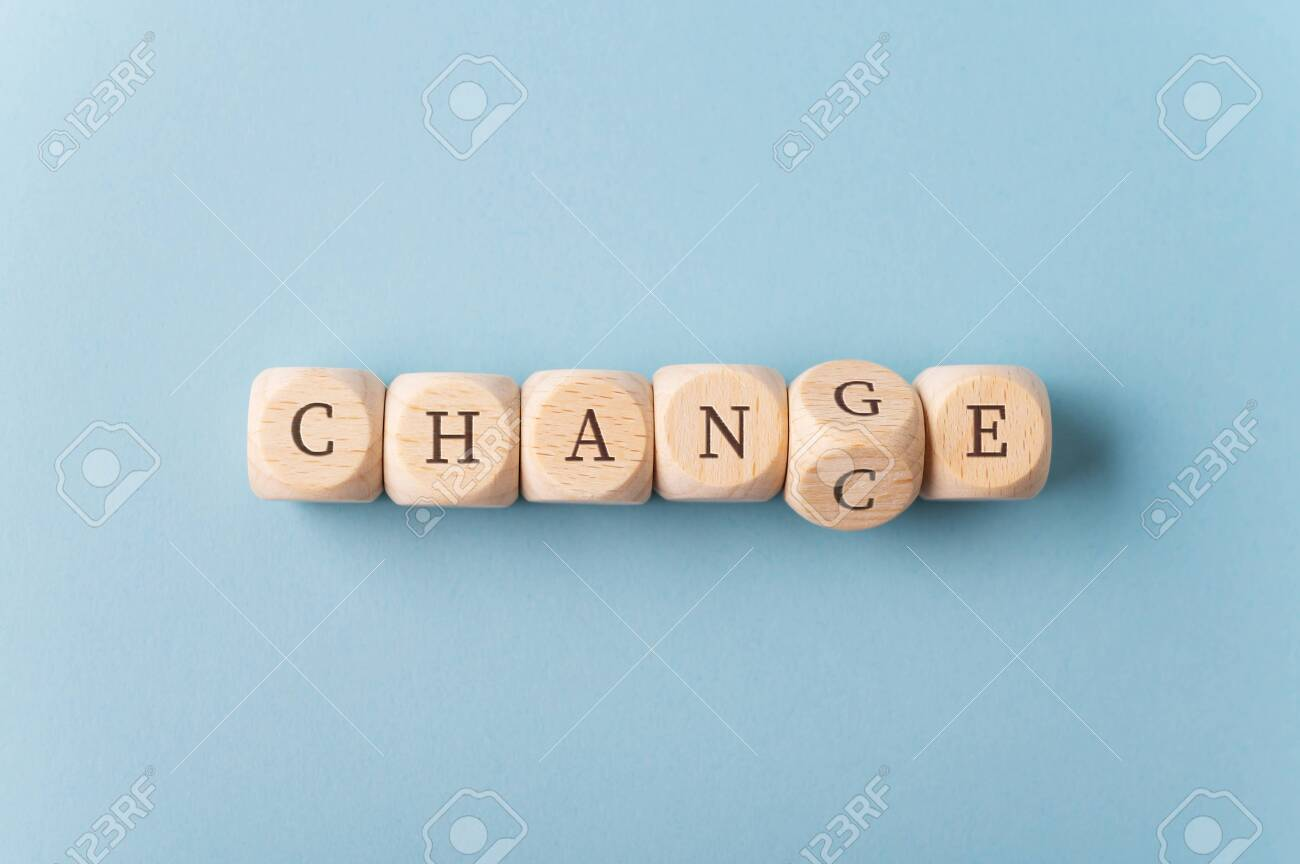 Word Change spelled with wooden dices with the dice carrying letter G turning to spell the word Chance. - 130111656