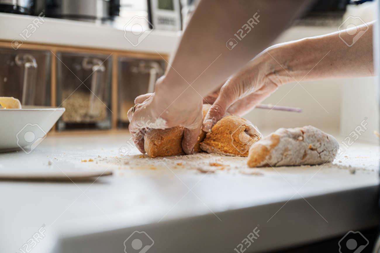 Low angle view of a woman preparing a dough for home made pasta on kitchen counter. - 169239390