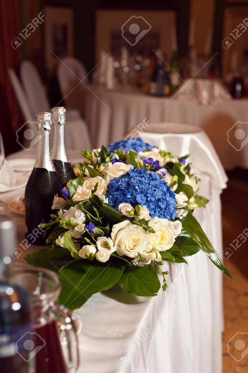 Wedding Table Decoration Blue Hydrangea And Cream Roses. Floral ...