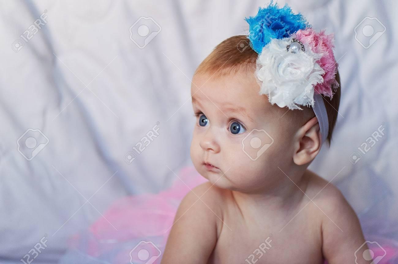 8115119082 Newborn baby girl wearing a white crocheted crown, ballerina tutu, and ballet  slippers.